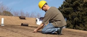 Inspection Of Buckling Shingles On A Roof