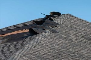 Wind Damage To A Roof After A Storm